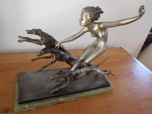 39Girl with Greyhounds' A large bronze figure group of a naked girl walking